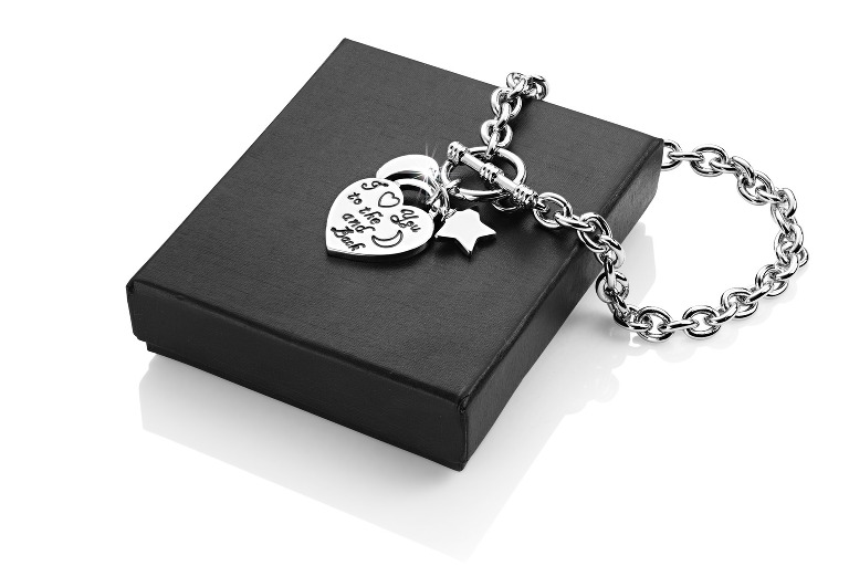 Silver bracelet with engraved heart on box