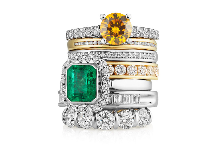 Jewellery photographers Tony May Images. Stack of diamond and gold eternity rings, half eternity, emerald, citrine.