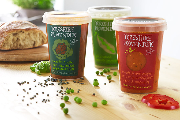 Three Yorkshire Provender soups in kitchen table setting.