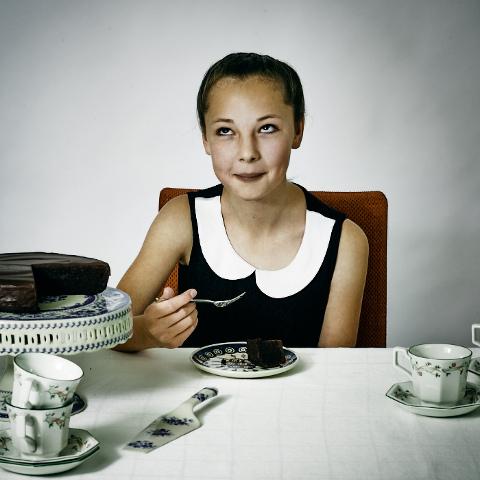 Teenage girl enjoying Bruce Bogtrotter luxury chocolate cake.