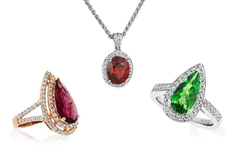 rhodolite, tsavoite and spessartite garnet rings and pendant by jewellery photographer Tony May