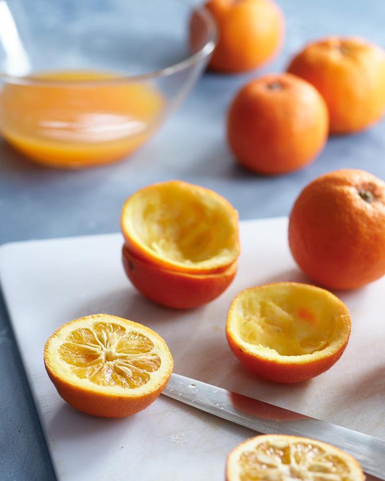 Halved and juiced Seville oranges