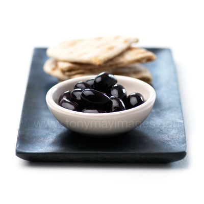 Olives and bread, food photography by Tony May